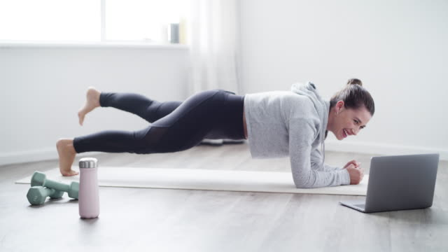 your workout buddy is a video call away - plank stock videos & royalty-free footage