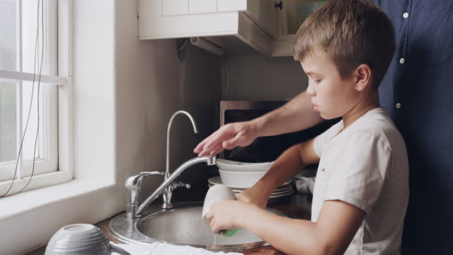 you're never too little to learn to wash the dishes - dishcloth stock videos & royalty-free footage