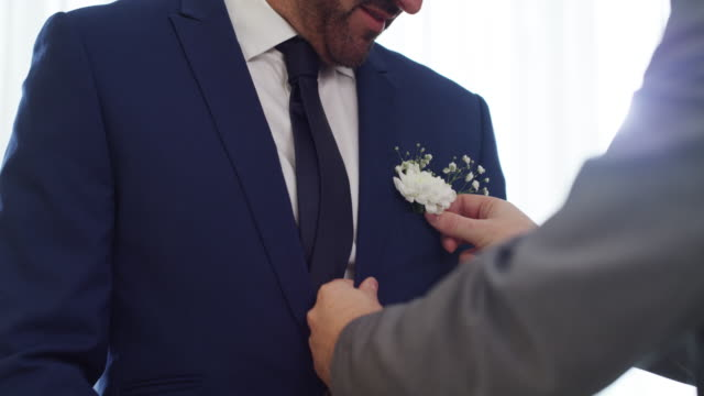 you're not fully dressed without a corsage - bridegroom stock videos & royalty-free footage