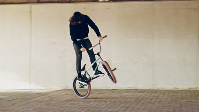 you're one trick away from a good mood - bmx cycling stock videos and b-roll footage