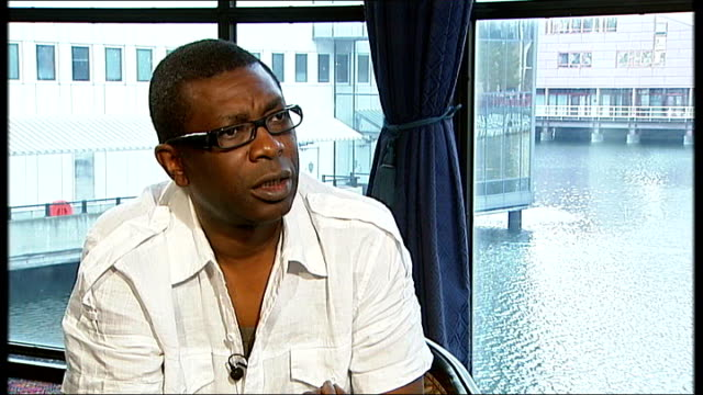 youssou n'dour interview sot talks of his music being world music do you still need white rock star to champion africa youssou n'dour interview sot... - モダンロック点の映像素材/bロール