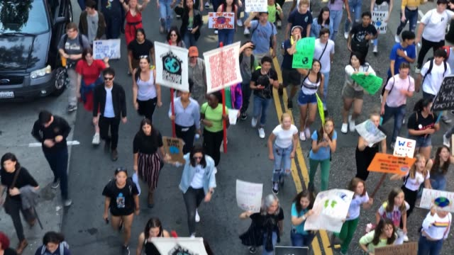 youth activists and their supporters march down jackson street during a global climate strike demonstration on september 20 2019 in san francisco... - streik stock-videos und b-roll-filmmaterial