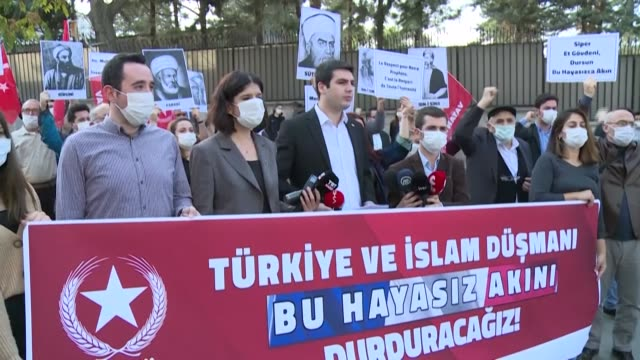 youth branch of the turkish nationalist vatan party gather in front of the french embassy in ankara to protest the publication of cartoons of the... - publication stock videos & royalty-free footage