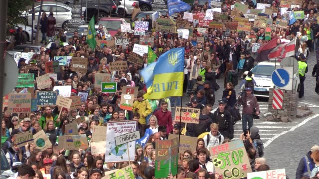 youth carry posters and shout slogans during the 'global climate strike' climate change action protest in kiev, ukraine, on 20 september, 2019.... - strike protest action stock videos & royalty-free footage