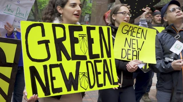 youth climate activist from sunrise nyc protesting outside senator chuck schumer's office building in midtown manhattan demanding that he support the... - 20 24 years stock videos & royalty-free footage