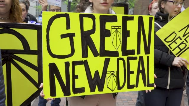 youth climate activist from sunrise nyc protesting outside senator chuck schumer's office building in midtown manhattan demanding that he support the... - sign stock videos & royalty-free footage
