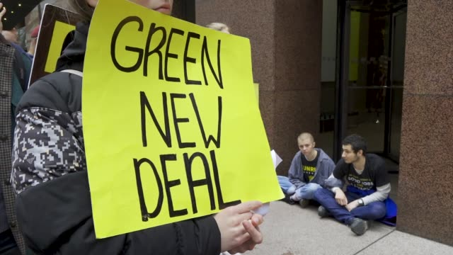 youth climate activist from sunrise nyc protesting outside senator chuck schumer's office building in midtown manhattan demanding that he support the... - climate action stock videos & royalty-free footage
