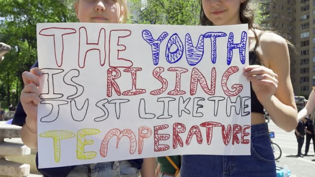 youth climate strike: nyc school students rallied at manhattan's columbus circle and marched to times square chanting about environmental issues... - campaigner stock videos & royalty-free footage