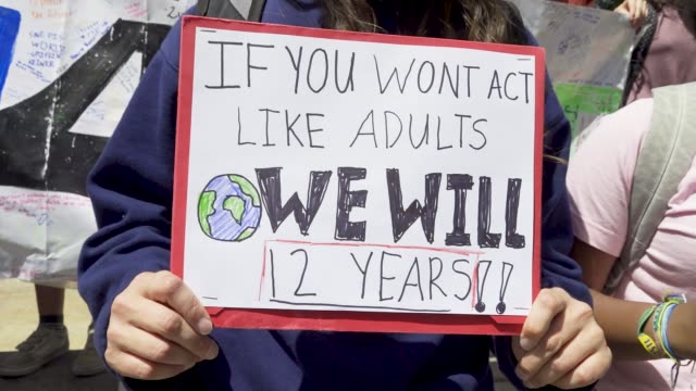 youth climate strike nyc school students rallied at manhattan's columbus circle and marched to times square chanting about environmental issues... - climate stock videos & royalty-free footage