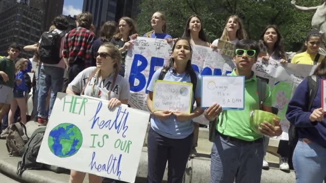 youth climate strike: nyc school students rallied at manhattan's columbus circle and marched to times square chanting about environmental issues... - ストライキ点の映像素材/bロール
