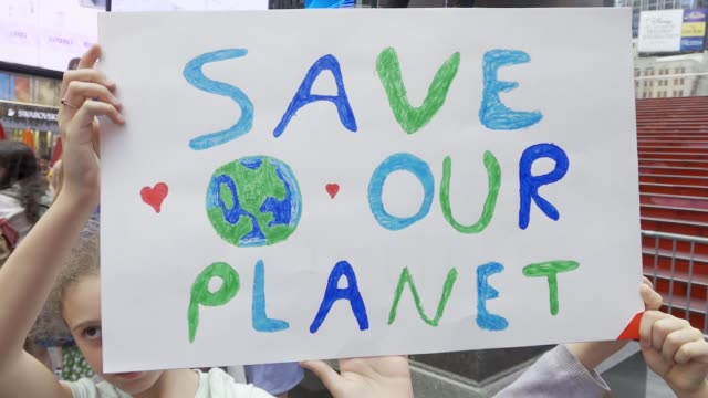 youth climate strike nyc school students rallied at manhattan's columbus circle and marched to times square chanting about environmental issues... - placard stock videos & royalty-free footage