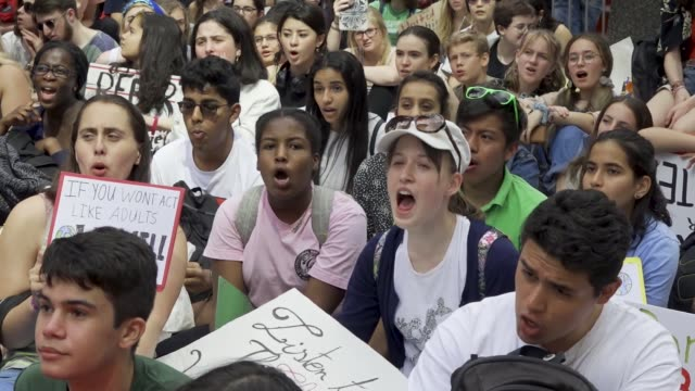youth climate strike nyc school students rallied at manhattan's columbus circle and marched to times square chanting about environmental issues... - strike protest action stock videos and b-roll footage