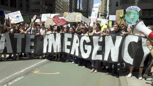 youth climate strike nyc school students rallied at manhattan's columbus circle and marched to times square chanting about environmental issues... - climate action stock videos & royalty-free footage