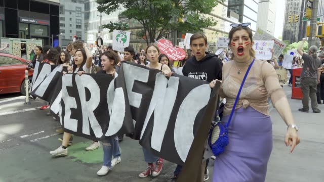 youth climate strike nyc school students rallied at manhattan's columbus circle and marched to times square chanting about environmental issues... - sprechgesang stock-videos und b-roll-filmmaterial
