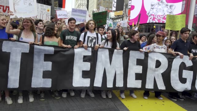 youth climate strike nyc school students rallied at manhattan's columbus circle and marched to times square chanting about environmental issues... - streik stock-videos und b-roll-filmmaterial
