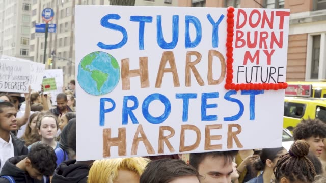 youth climate strike: students of all ages rallied in downtown manhattan's city hall park and marched to midtown columbus circle and onto the... - individual event stock videos & royalty-free footage