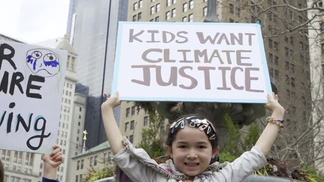 youth climate strike: students of all ages rallied in downtown manhattan's city hall park and marched uptown to columbus circle where they rallied... - protestor stock videos & royalty-free footage