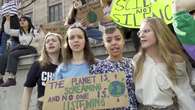 youth climate strike: students of all ages rallied in downtown manhattan's city hall park and marched uptown to columbus circle where they rallied... - individual event stock videos & royalty-free footage
