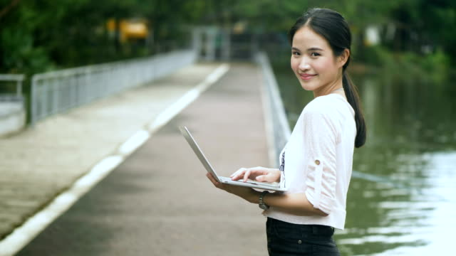 Youth Culture : Asian woman using note book