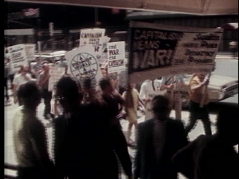 youth hold up signs march to protest us involvement in asia - vietnamkrieg stock-videos und b-roll-filmmaterial