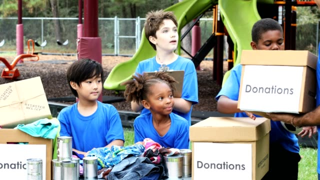 youth sports team collects items for disaster relief - pre adolescent child stock videos & royalty-free footage