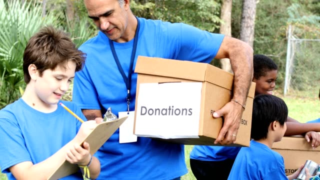 youth sports team collects items for disaster relief - accidents and disasters stock videos & royalty-free footage
