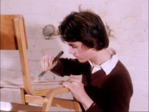 government programme for school leavers; west london: boys in furniture workshop boy working on chair screws fastened into seat white schoolboy... - unemployment stock videos & royalty-free footage