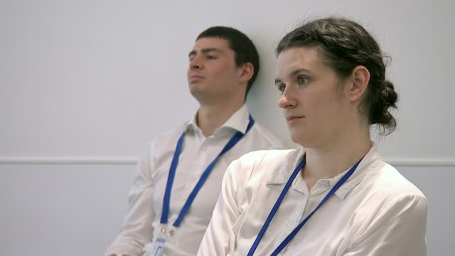 stockvideo's en b-roll-footage met youth worker trains met police's newest recruits on race and unconscious bias london uk various shots of sayce holmeslewis during talk to new met... - new not politics