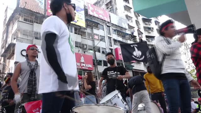 youth-led protesters kick off a rally in downtown yangon with drumming and singing sessions, as a drumming group sings their new song titled... - protestor stock videos & royalty-free footage