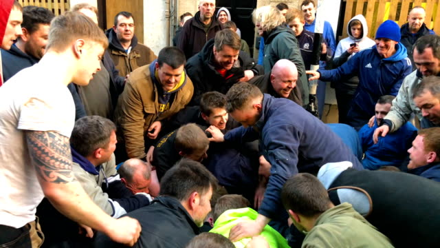 youths chase after the leather ball during the annual 'fastern eve handba' event in jedburgh's high street in the scottish borders on february 22... - annual event stock videos and b-roll footage
