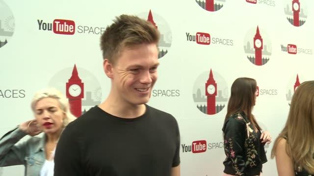 Red carpet arrivals ENGLAND London EXT Sign 'YouTube Spaces' / Casper Lee interview SOT / Victoria MacGrath interview SOT / Unidentified man...