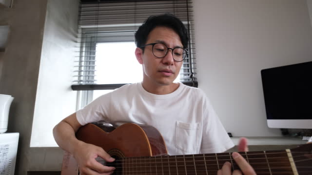 youtuber singing and playing guitar - musician stock videos & royalty-free footage
