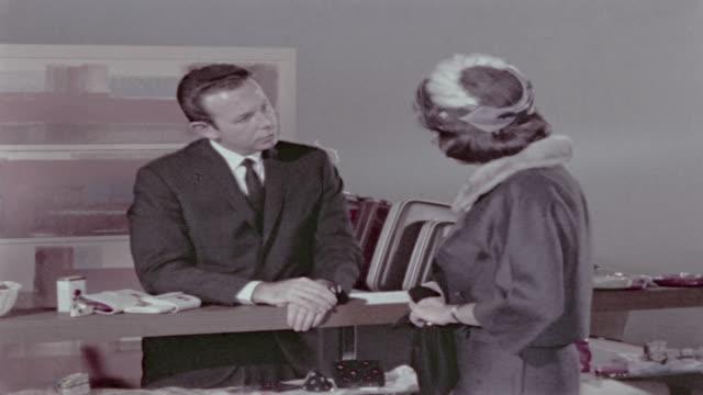 vídeos de stock, filmes e b-roll de you've sold me, mrs. marlowe! - sales occupation