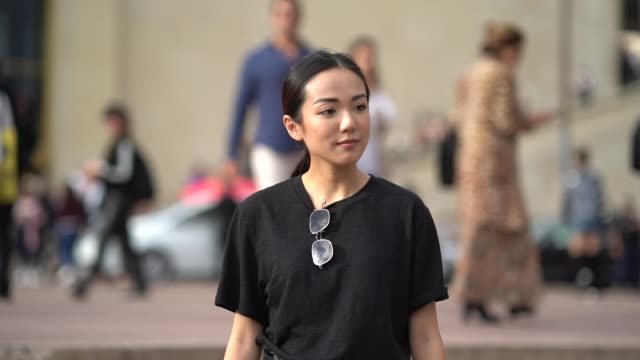 yoyo cao wears a black tshirt tartan pants outside hermes during paris fashion week womenswear spring/summer 2018 on october 2 2017 in paris france - hermes designer label stock videos and b-roll footage