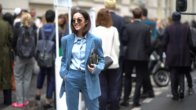 Yoyo Cao wears a blue blazer jacket and a blue suit after Chloe during Paris Fashion Week Womenswear Spring/Summer 2018 on September 28 2017 in Paris...