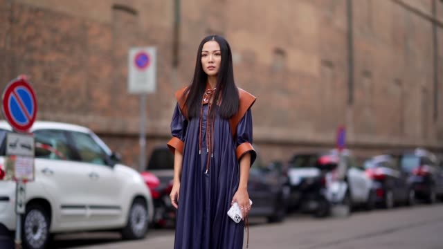 yoyo cao wears a navy blue dark long pleated dress with brown leather shoulder pads outside sportmax during milan fashion week fall/winter 20202021... - navy blue stock videos & royalty-free footage