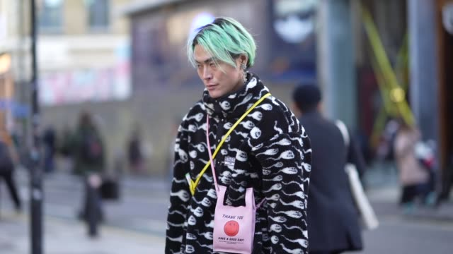 yu masui wears a yellow shoulder strapped mini bag a black and white outfit with printed spermatozoids a mini bag with a printed smiley and the... - spring summer collection stock videos & royalty-free footage