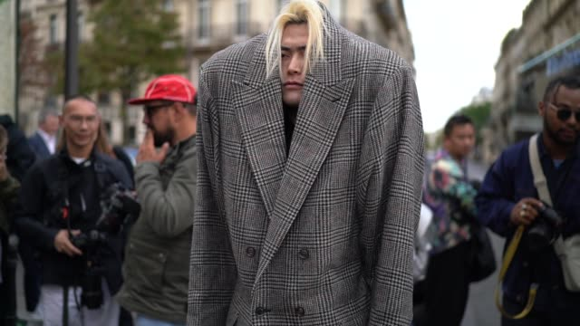 yu masui wears an oversized blazer long jacket with printed checked pattern, outside cdg comme des garçons, during paris fashion week - womenswear... - ストリートスナップ点の映像素材/bロール