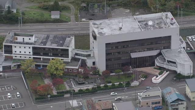 aerial yubari, a former coal-mining town, in hokkaido - 政府の建物点の映像素材/bロール