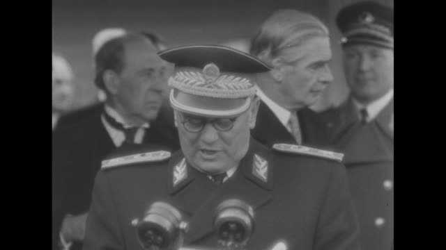 Yugoslav President Marshal Josip Tito reads statement upon his arrival in London British Foreign Secretary Anthony Eden stands behind with others SOT...