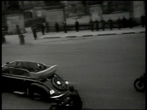 yugoslavia dictator josip tito in convertible car w/ motorcycle escorts arriving at castle, prague. czech republic soldiers w/ rifles at attention.... - 1945 stock-videos und b-roll-filmmaterial