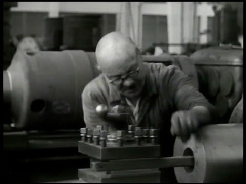 yugoslavian worker using micrometer on machine. workers fixing electrical equipment. vs woman & man operating machines. men looking at plans.... - micrometer stock videos & royalty-free footage