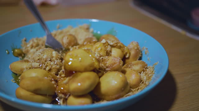 yum ragam with penut and sugar to combine well, it has a sour, spicy and sweet thai taste. - sour taste stock videos & royalty-free footage