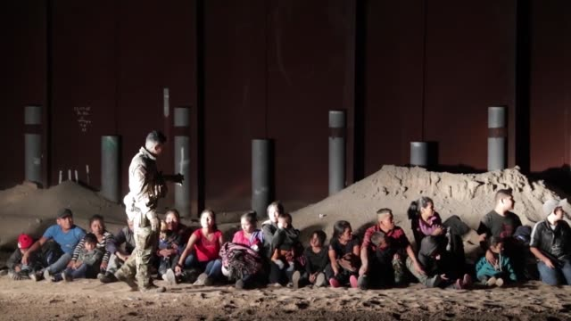 yuma border patrol agents apprehend a large group of illegal immigrants clearing sand and making entry under an older section of border wall near san... - frame border stock videos & royalty-free footage