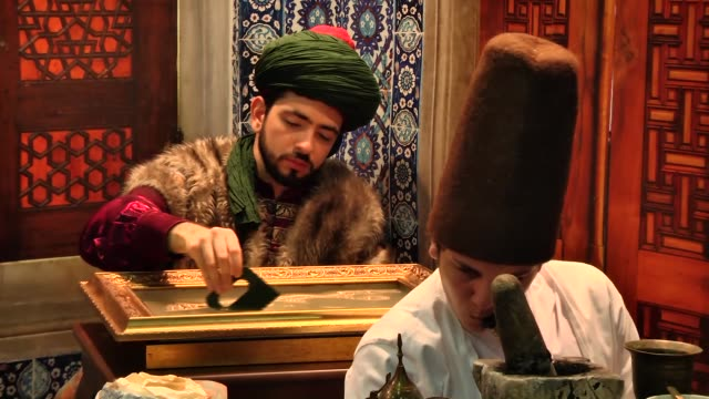 yunus emre institute introduce 'nakkashane: the journey of books in the ottoman palace' at cnr book fair in istanbul, turkey on 3 march, 2015.... - tradition stock videos & royalty-free footage