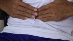 Yuong man holding his stomach in pain