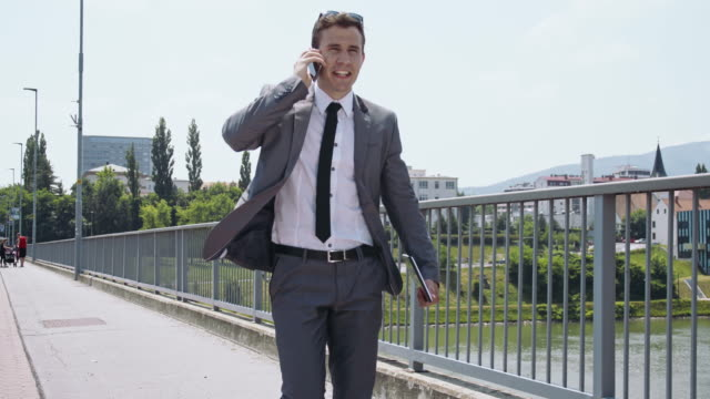 yuppie on the phone in the city - yuppie stock videos and b-roll footage