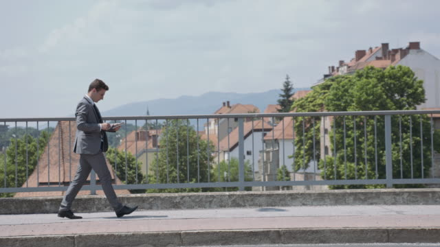 yuppie rejoicing a good news on the bridge in city - yuppie stock videos and b-roll footage