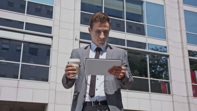 yuppie rejoicing in front of the office building - yuppie stock videos and b-roll footage