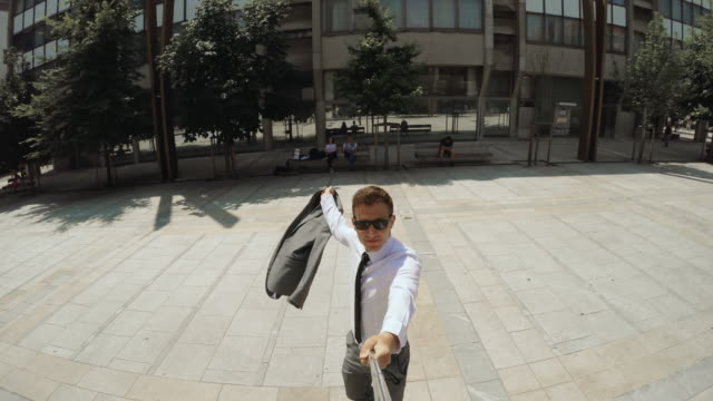 yuppie taking a selfie at business district - yuppie stock videos and b-roll footage